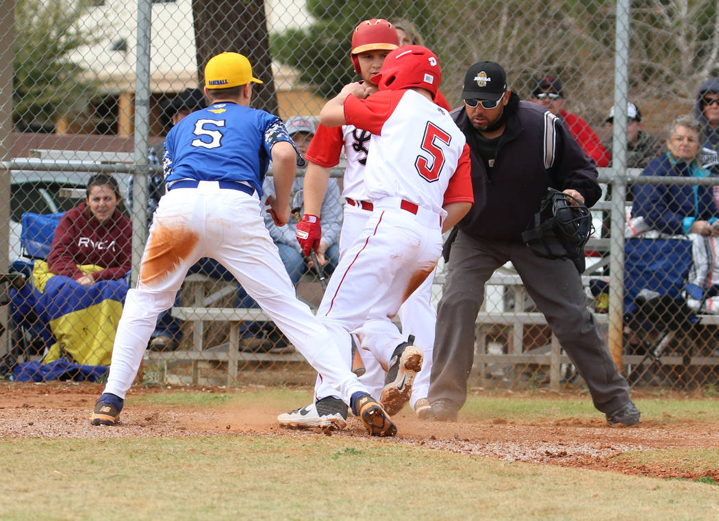 Lincoln County High's Cody Howard (5) comes home safe as Pahranagat Valley High School's Presto ...