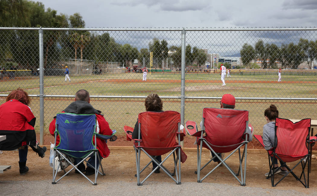 Parents watch a baseball game between Pahranagat Valley High School and Lincoln County High dur ...