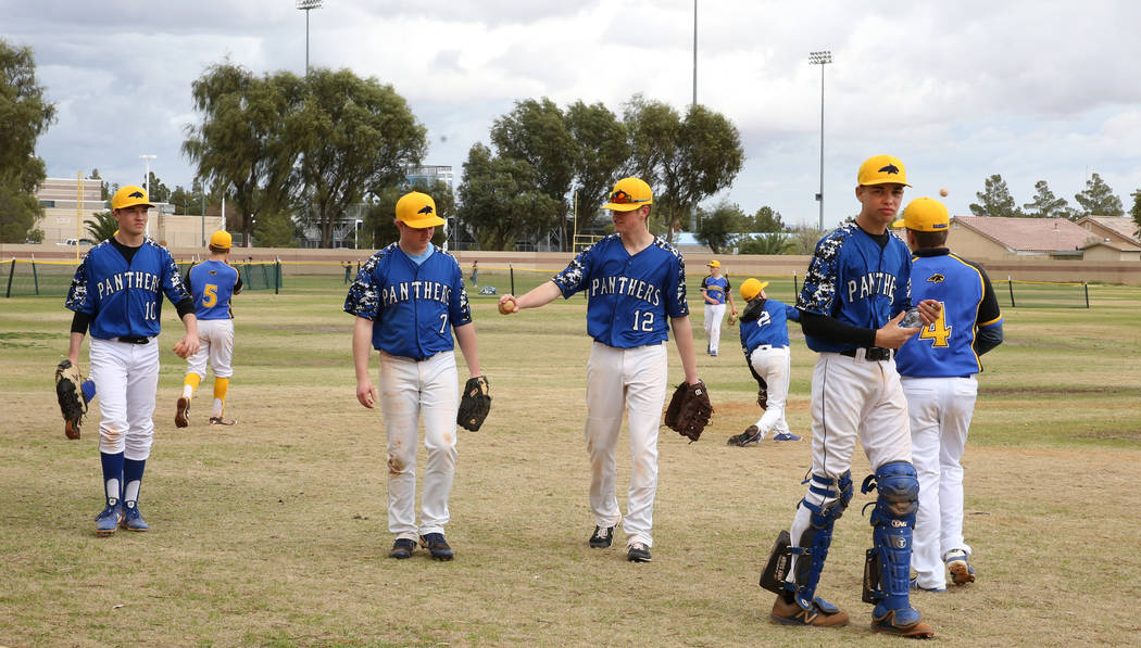 Pahranagat Valley High School players get back to the dugout after warming up during the Spring ...