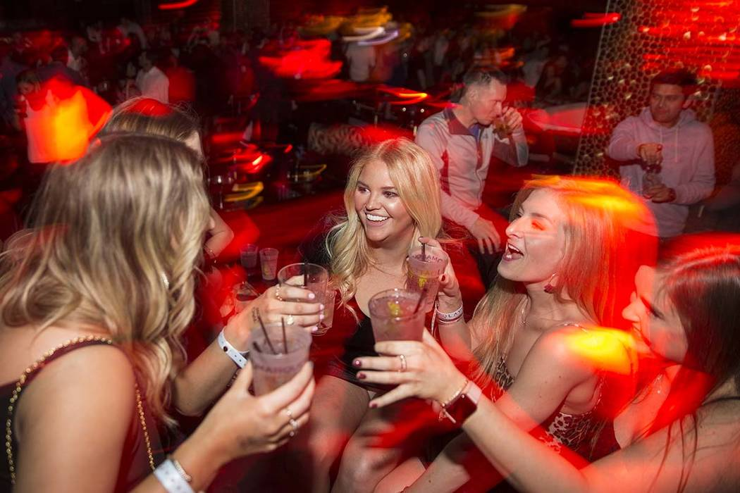 Clubgoers socialize at Tao Las Vegas at The Grand Canal Shoppes in Las Vegas, Jan. 31, 2019. (B ...