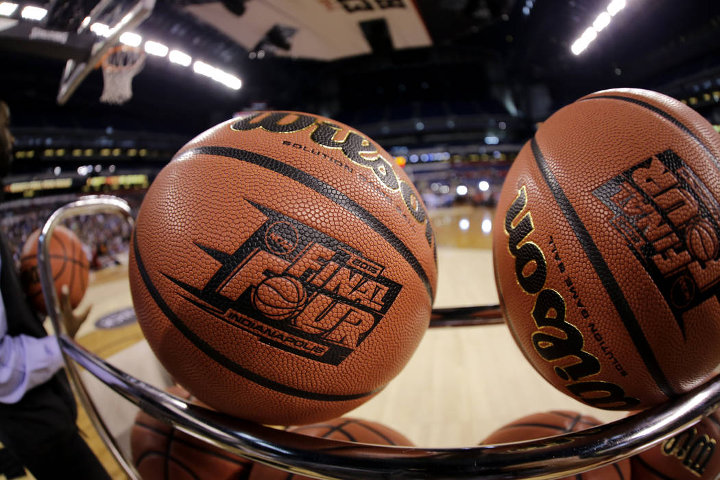 FILE - In this April 3, 2015, file photo, basketballs sit in a rack during Michigan State pract ...