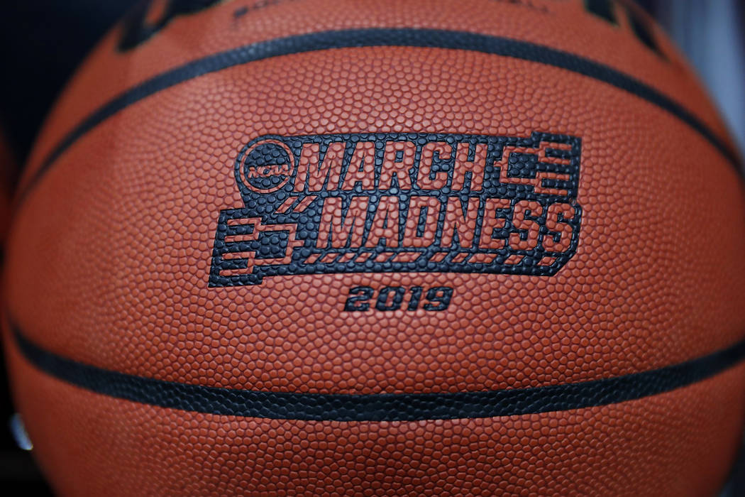 A basketball with a logo is seen before a first round men's college basketball game between Min ...