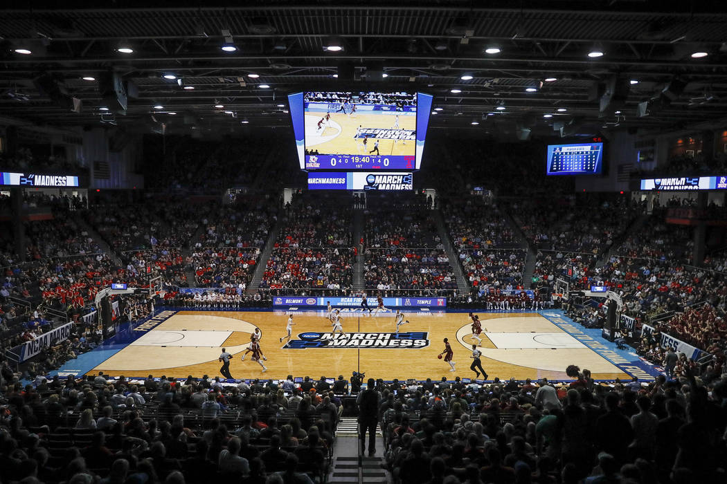 Spectators watch from the stands during the first half of a First Four game of the NCAA college ...