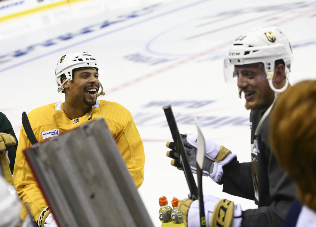 Golden Knights right wing Ryan Reaves (75) and defenseman Nate Schmidt (88) share a laugh while ...