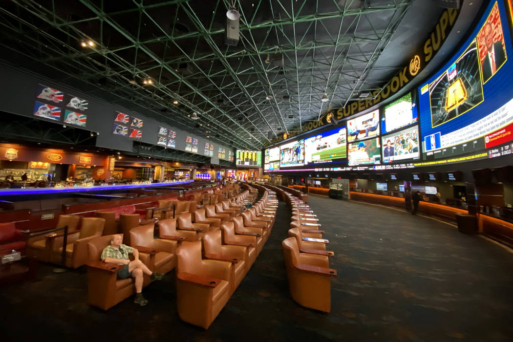 David Gustafson of Jackson, Wyo. watches TV in the normally crowded Westgate sportsbook Friday, ...