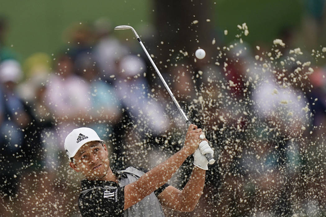 Xander Schauffele hits from a bunker on the seventh hole during the final round for the Masters ...