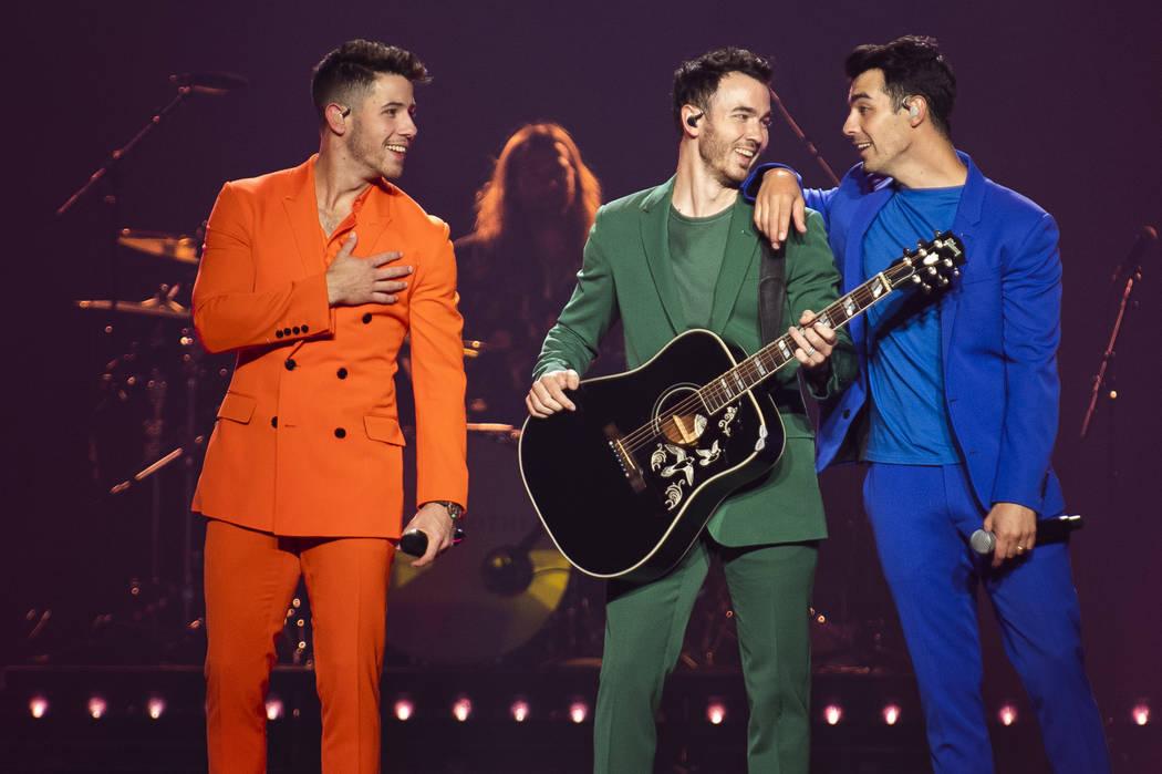 Nick Jonas, from left, Kevin Jonas, and Joe Jonas, of The Jonas Brothers, perform on stage on F ...
