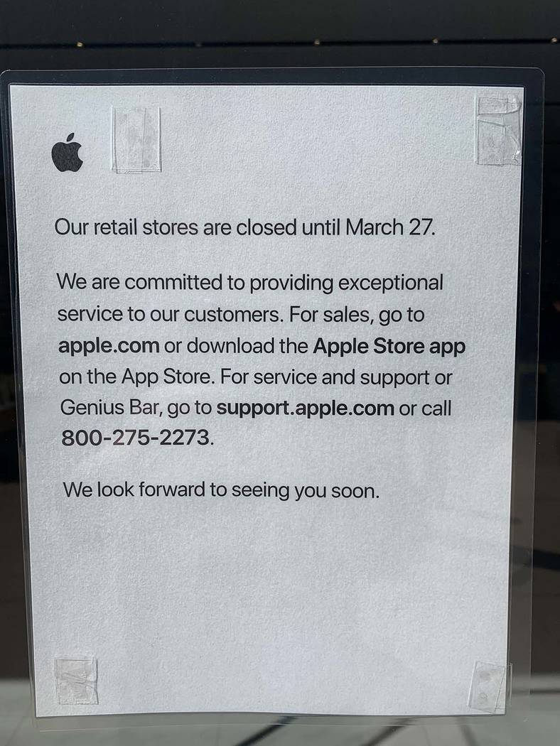 A sign on the door at the Apple Store in downtown Summerlin alerts customers that the store is ...