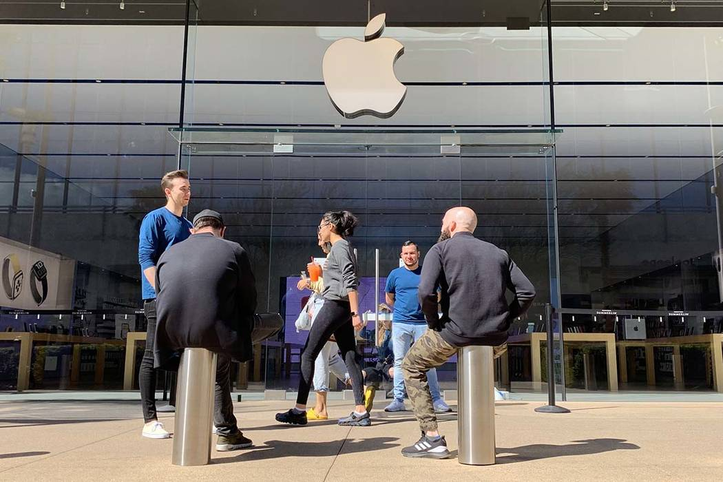Staff at the Apple Store in downtown Summerlin alert customers that the store is closed on Satu ...