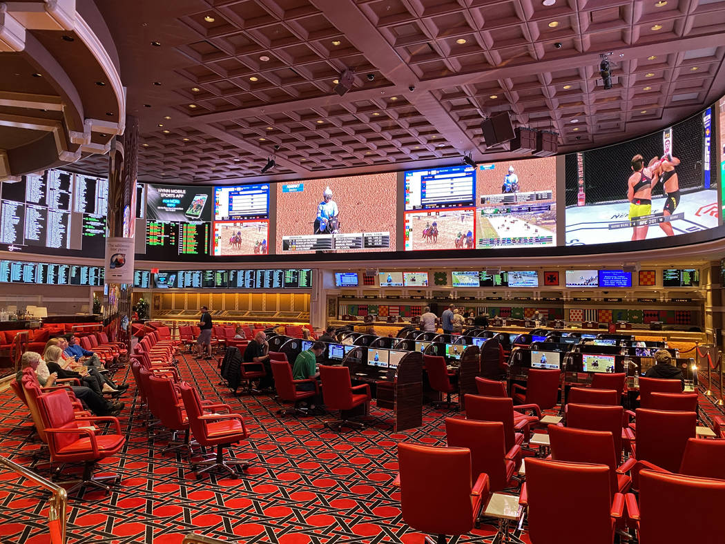 The Wynn Las Vegas sports book is largely empty on Saturday, March 14, 2020, in Las Vegas. (Ben ...
