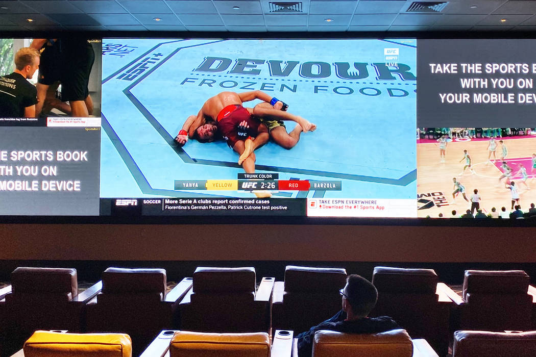 A single guest at the sports book at The Cromwell watches UFC on Saturday, March 14, 2020, in L ...