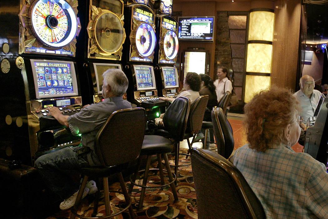 In this June 8, 2006, file photo, Patrons at the San Manuel Indian Bingo & Casino play slot mac ...