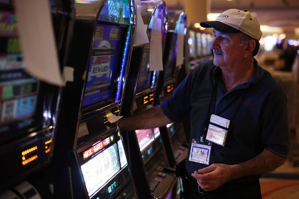 Bob Genereux, 58, works a gaming machine at the Valley Forge Casino Resort on Tuesday, Feb. 28, ...