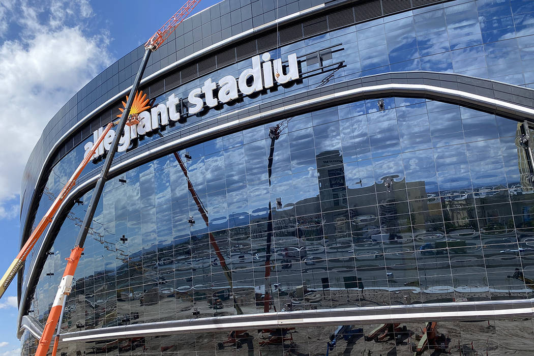 """Yesco crews removed the """"m"""" on the Allegiant Stadium sign Sunday, March 15, 2020, to readjust i ..."""
