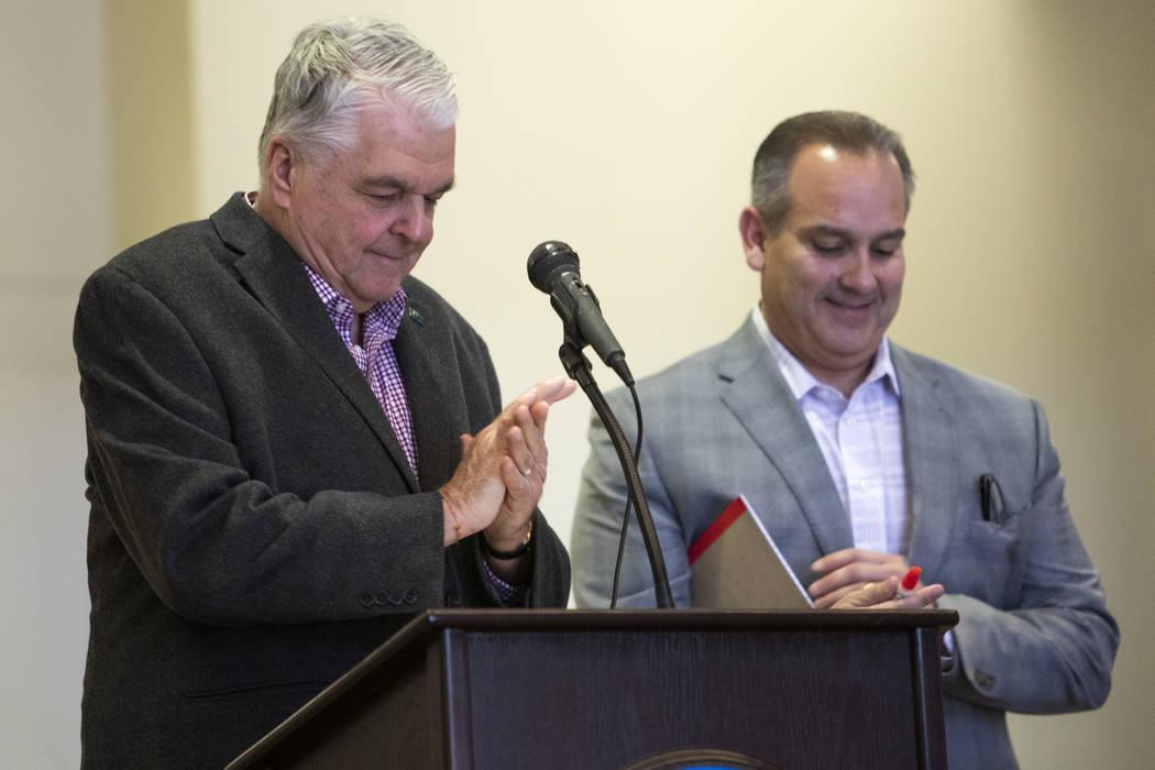 Gov. Steve Sisolak and CCSD Superintendent Jesus Jara use hand sanitizer before announcing that ...