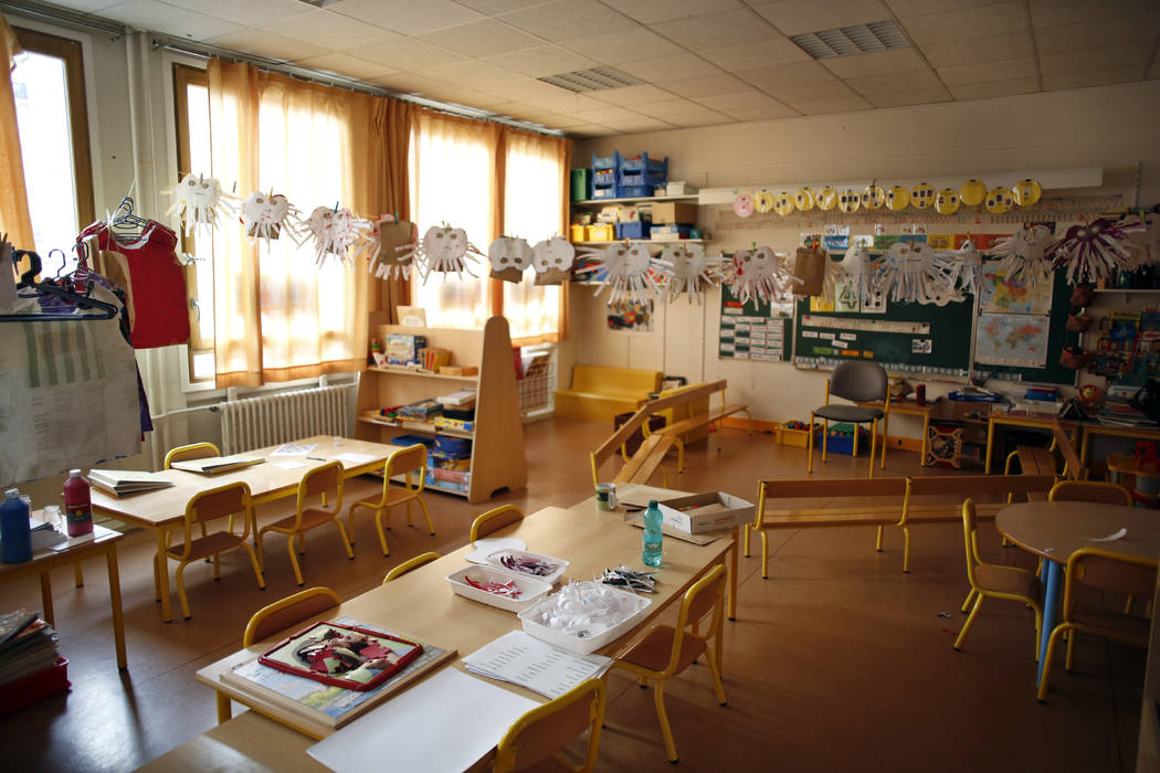 An empty classroom is seen at a closed school in Paris, Monday, March 16, 2020. France plans to ...