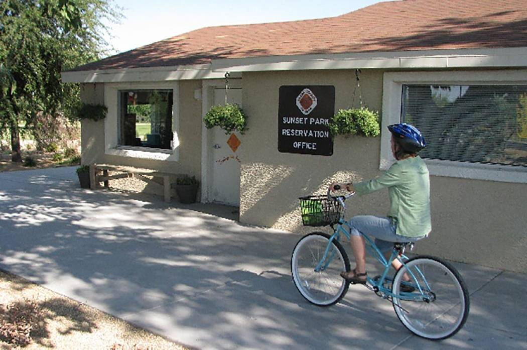A woman rides a bike at the Sunset Park Reservation office. (Las Vegas Review-Journal)