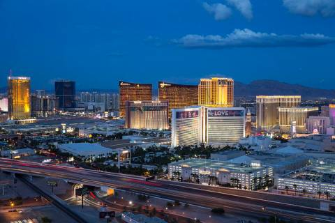 The Las Vegas Strip lights up at dusk as seen from the VooDoo Lounge atop the Rio. (Las Vegas R ...
