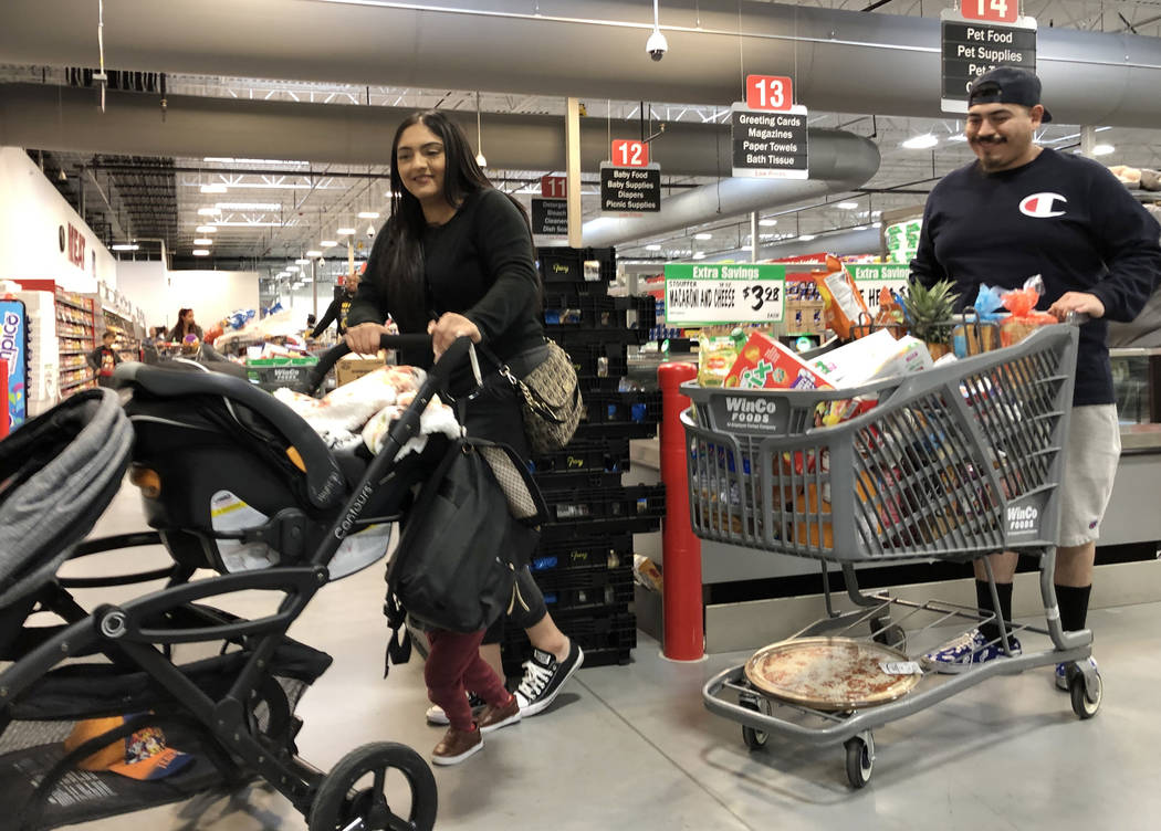 Virginia Rodriguez and her husband Jesse De La Torre shop at WinCo Foods on Monday, March 16, 2 ...