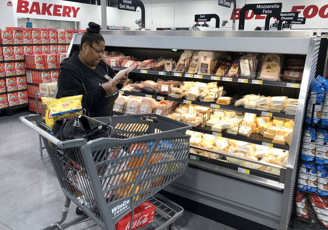 A customer, who declined to give her name, shops at WinCo Foods on Monday, March 16, 2020, in L ...