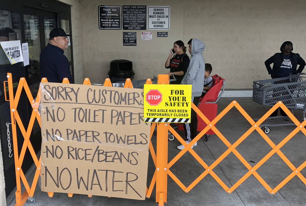 A list of sold out items are posted as customers wait in line at WinCo Foods on Monday, March 1 ...