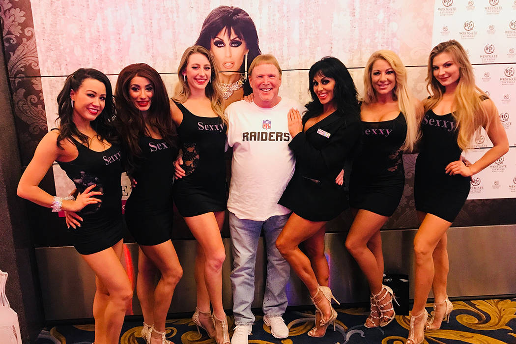 """Raiders owner Mark Davis is shown with Jennifer Romas, at his left, and the cast of """"Sexxy"""" at ..."""