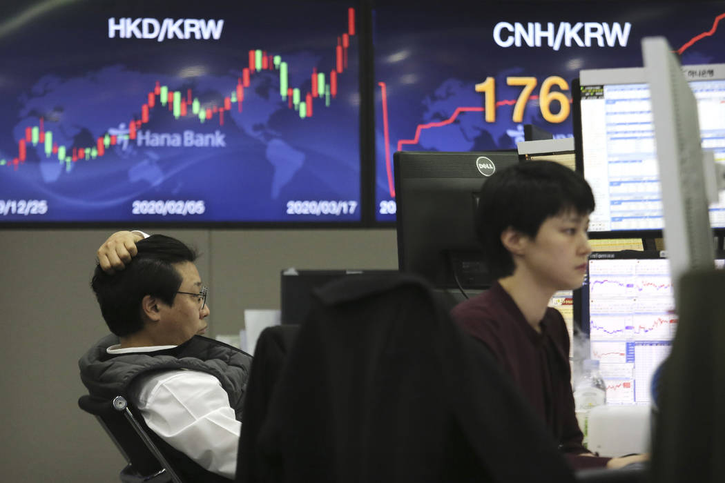 Currency traders watch monitors at the foreign exchange dealing room of the KEB Hana Bank headq ...