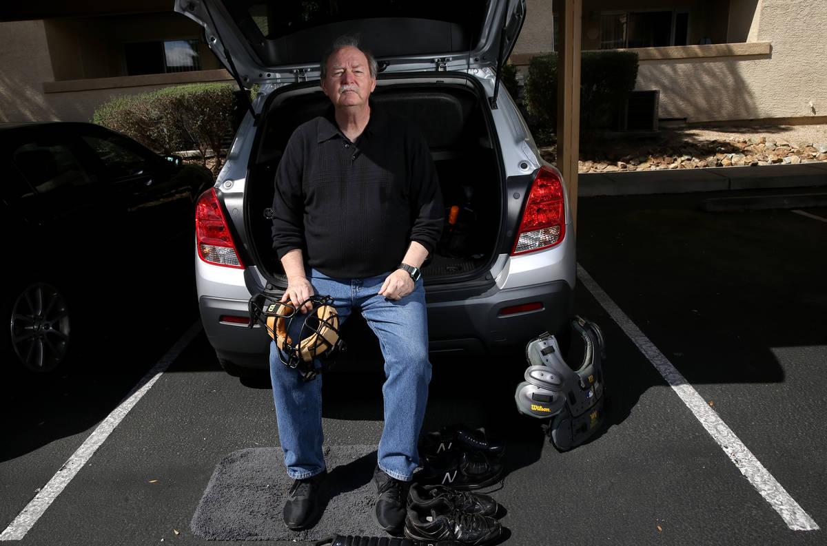 "High school umpire Jim Bullock in his ""locker room/office"" at his Las Vegas home Tues ..."