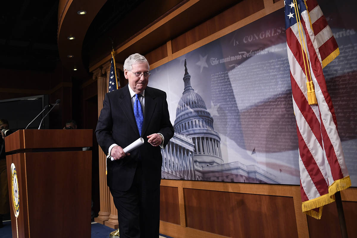 Senate Majority Leader Mitch McConnell of Ky., walks off of the stage following a news conferen ...