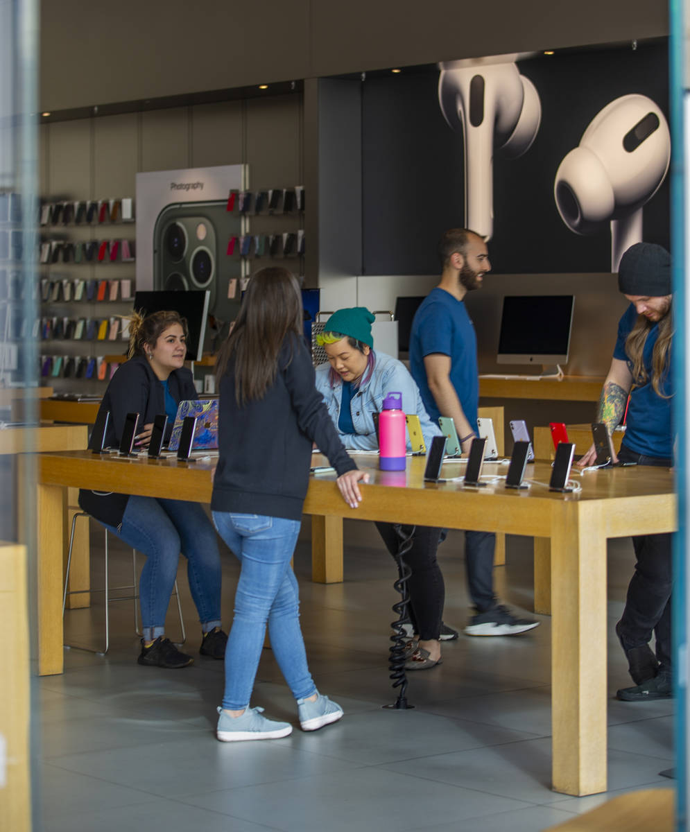 Apple Store employees wrap up things as their store is now closed until March 27th at Downtown ...