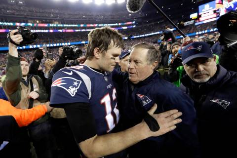 FILE - In this Jan. 21, 2018, file photo, New England Patriots quarterback Tom Brady, left, hug ...