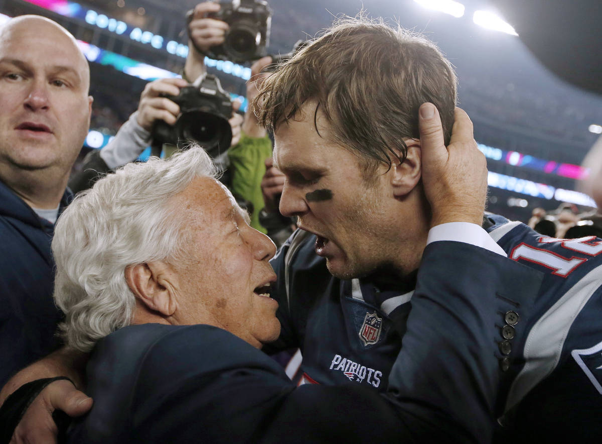 FILE - In this Jan. 21, 2018, file photo, New England Patriots owner Robert Kraft, left, embrac ...
