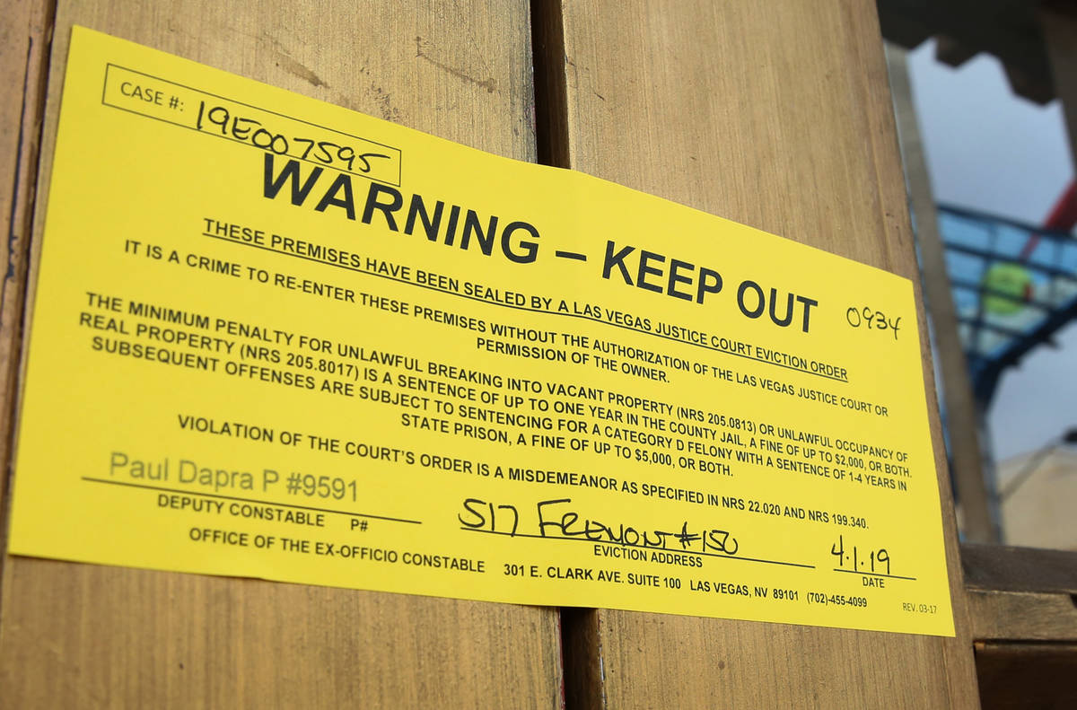 An eviction notice is seen placed on the door at Beauty Bar on Monday, April 1, 2019, in Las Ve ...