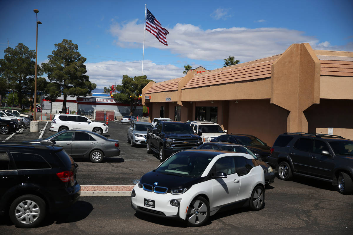 People line up to leave a swab sample at the Sahara Urgent Care & Wellness center in Las Vegas, ...