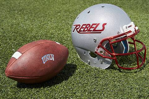 UNLV football helmet and ball (R. Marsh Starks / UNLV Creative Services)