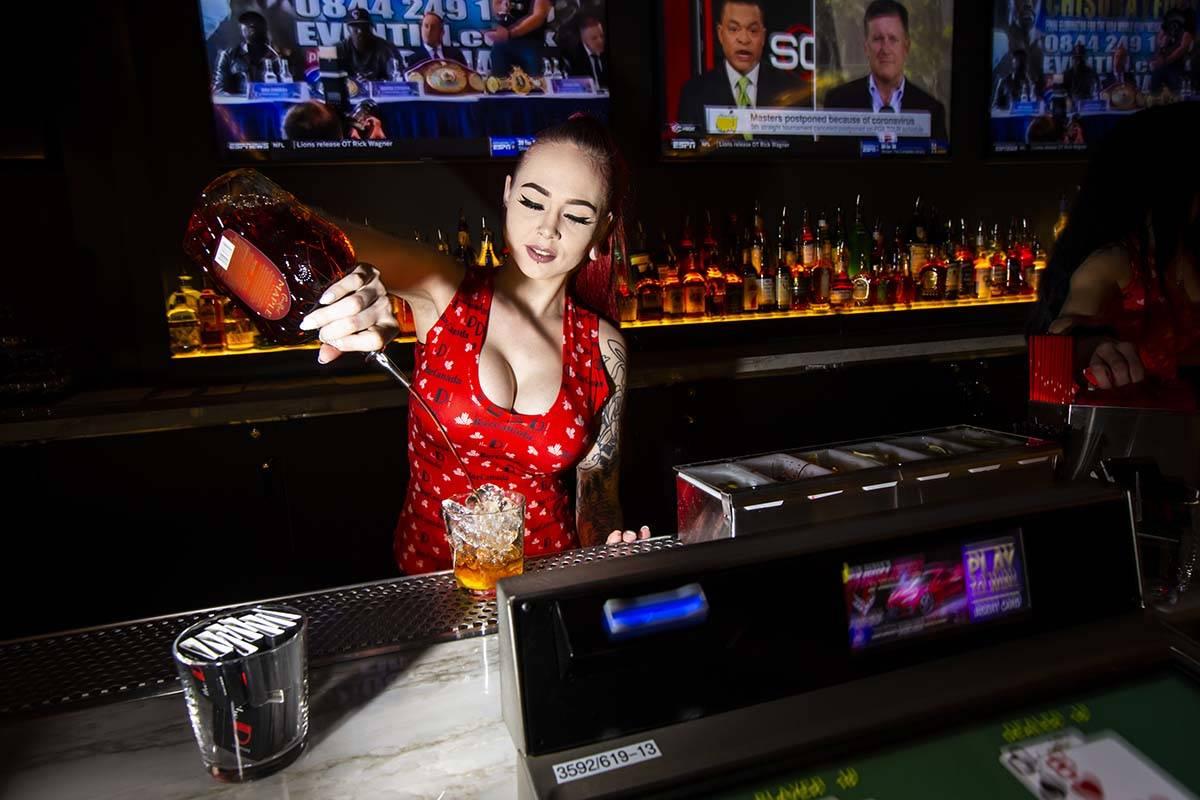 "Bartender Hunter Cox prepares ""The Old Canadian Way"" at BarCanada at the D Las Vegas ..."