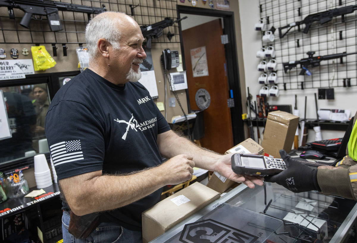 Mark Hames receives a shipment of more gun products at 2nd Amendment Gun Shop on Tuesday, March ...