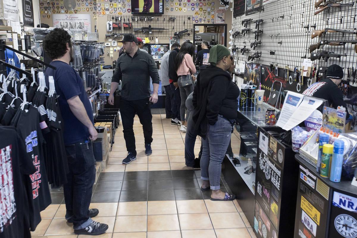 Customers shop at 2nd Amendment Gun Shop on Tuesday, March 17, 2020, in Las Vegas. (Ellen Schmi ...