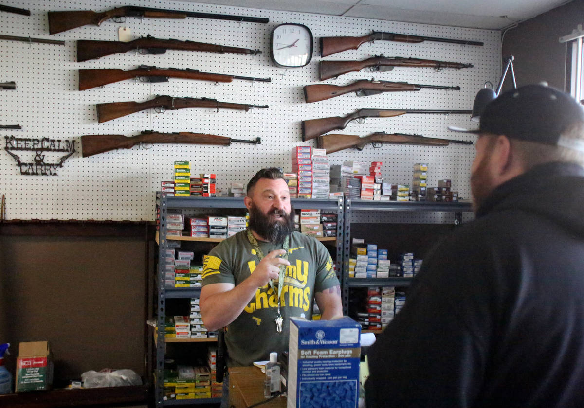 Sales of guns and ammo have been high at Elite Firearms where salesman Joseph Potter assists a ...