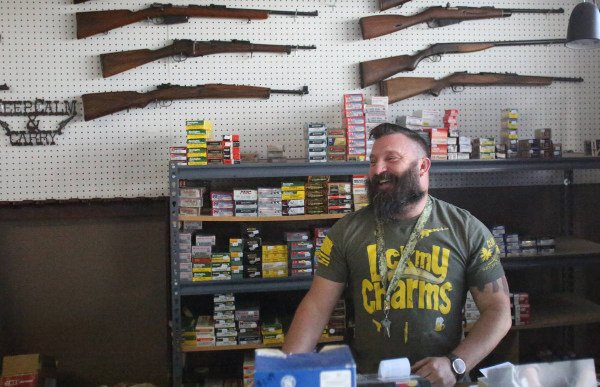Joseph Potter of Elite Firearms on Sahara Avenue says sales of guns and ammo have been high at ...