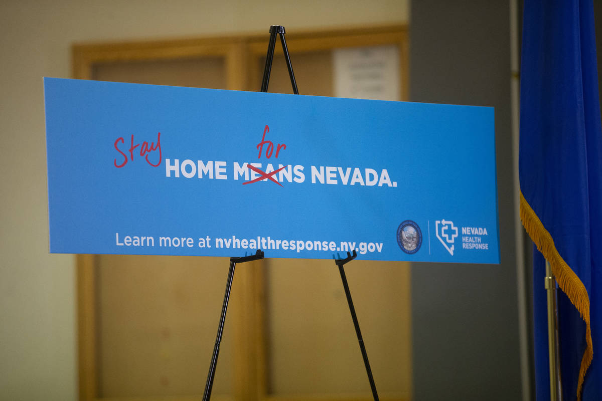 Signage urges Nevada residents to stay home during Gov. Steve Sisolak's press conference to ann ...