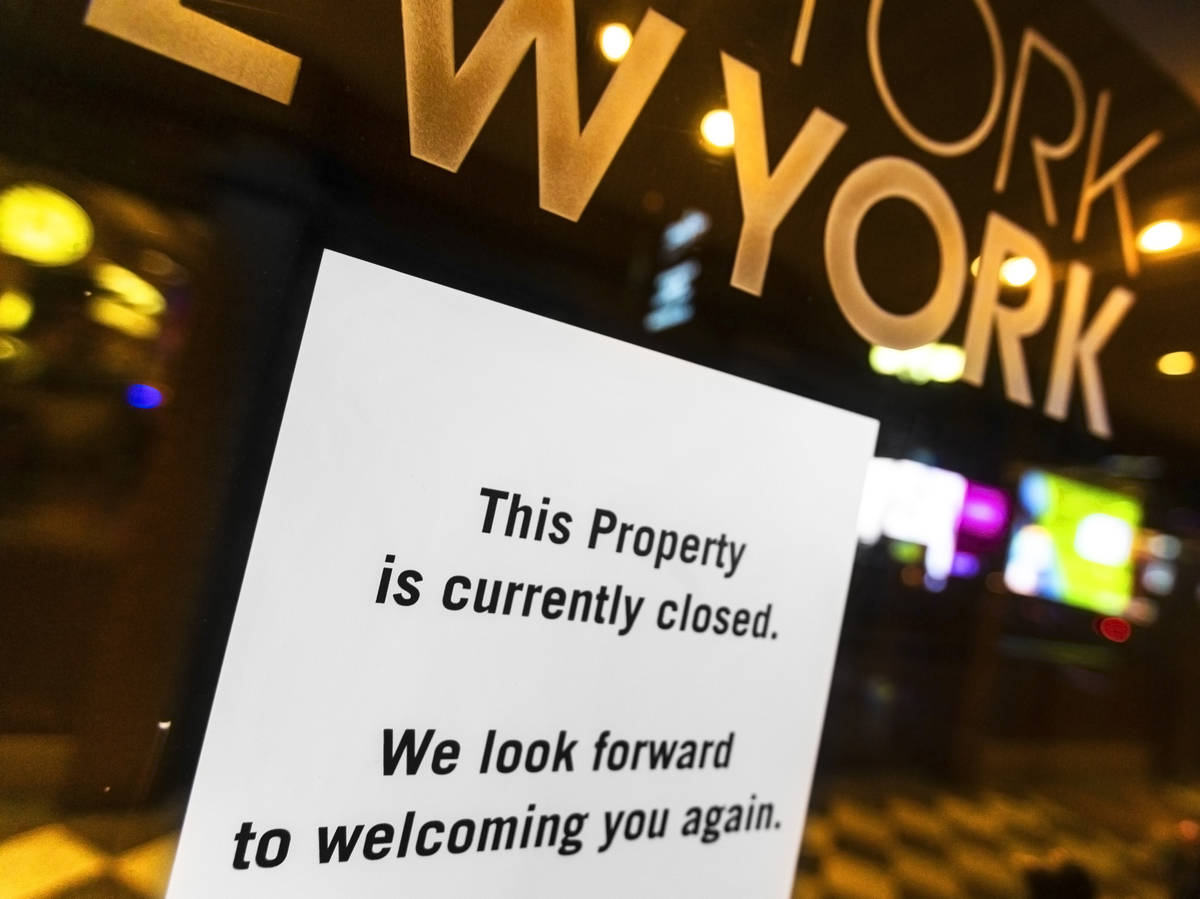 A closed sign is posted on the door of New York-New-York due to concerns related to the spread ...