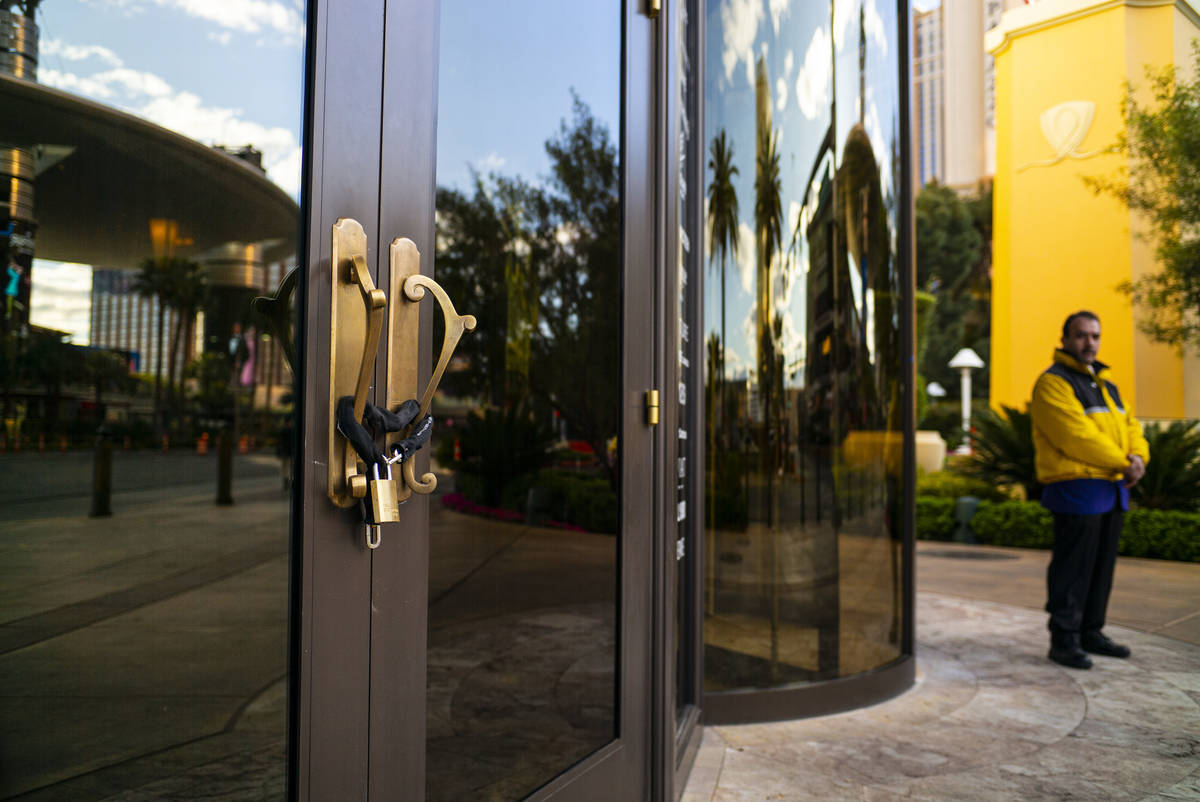 An entrance to Wynn Las Vegas is locked as the resort shuts down operations in Las Vegas on Tue ...