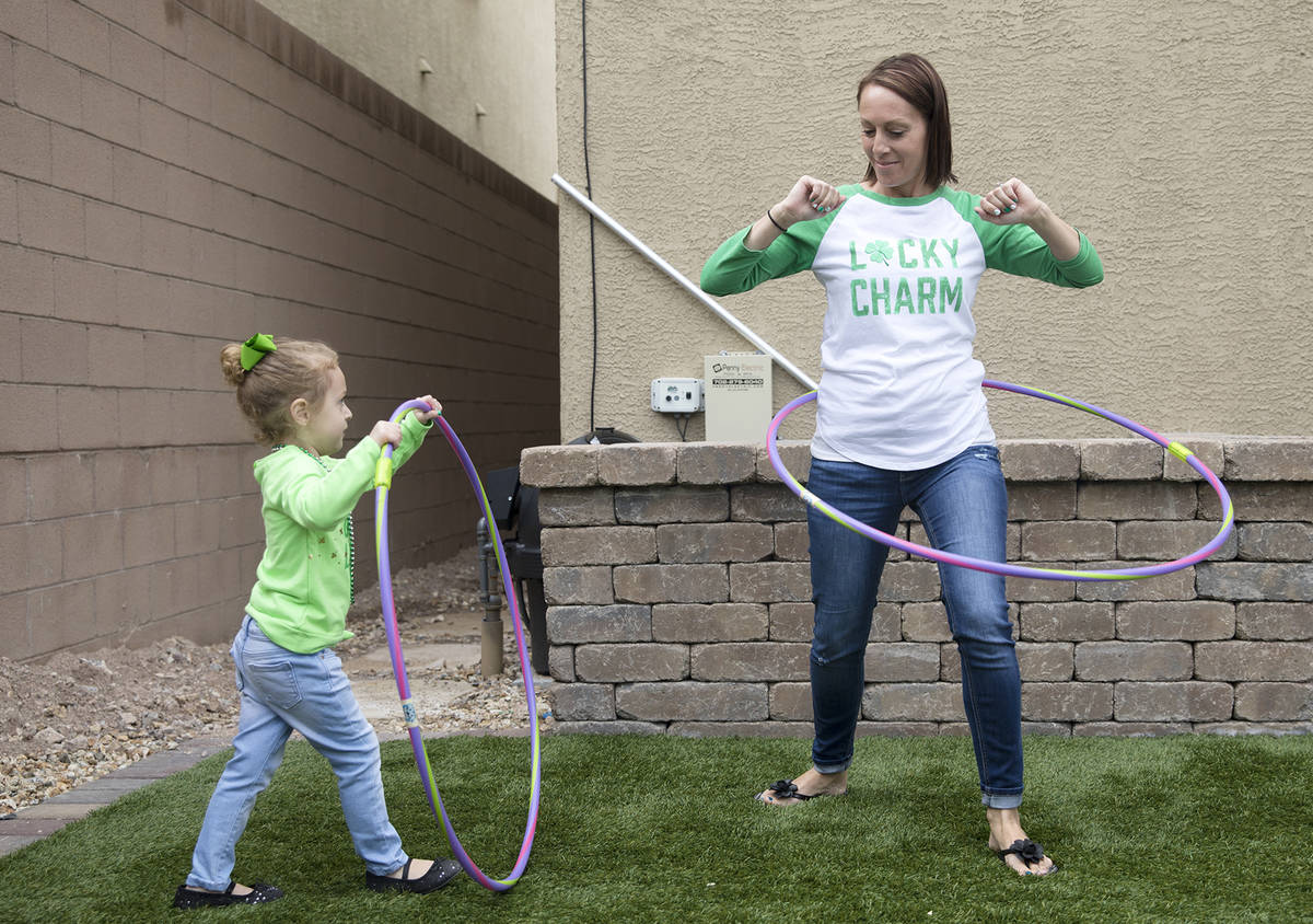Angie Dolechal, 3, left, plays with her mother Maria Dolechal, right, at their home in Henderso ...