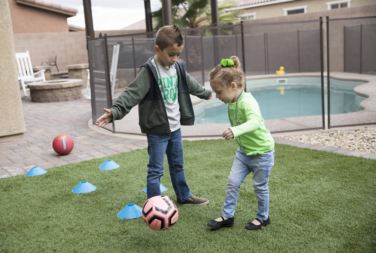 Alex Dolechal, 6, left, plays with his sister Angie Dolechal, 3, right, at their home in Hender ...
