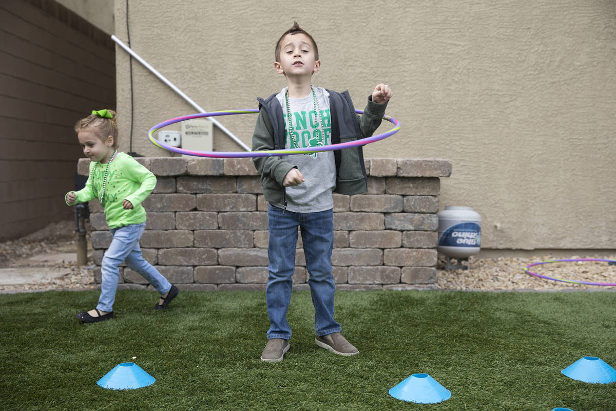 Angie Dolechal, 3, left, plays with her brother Alex Dolechal, 6, at their home in Henderson, T ...