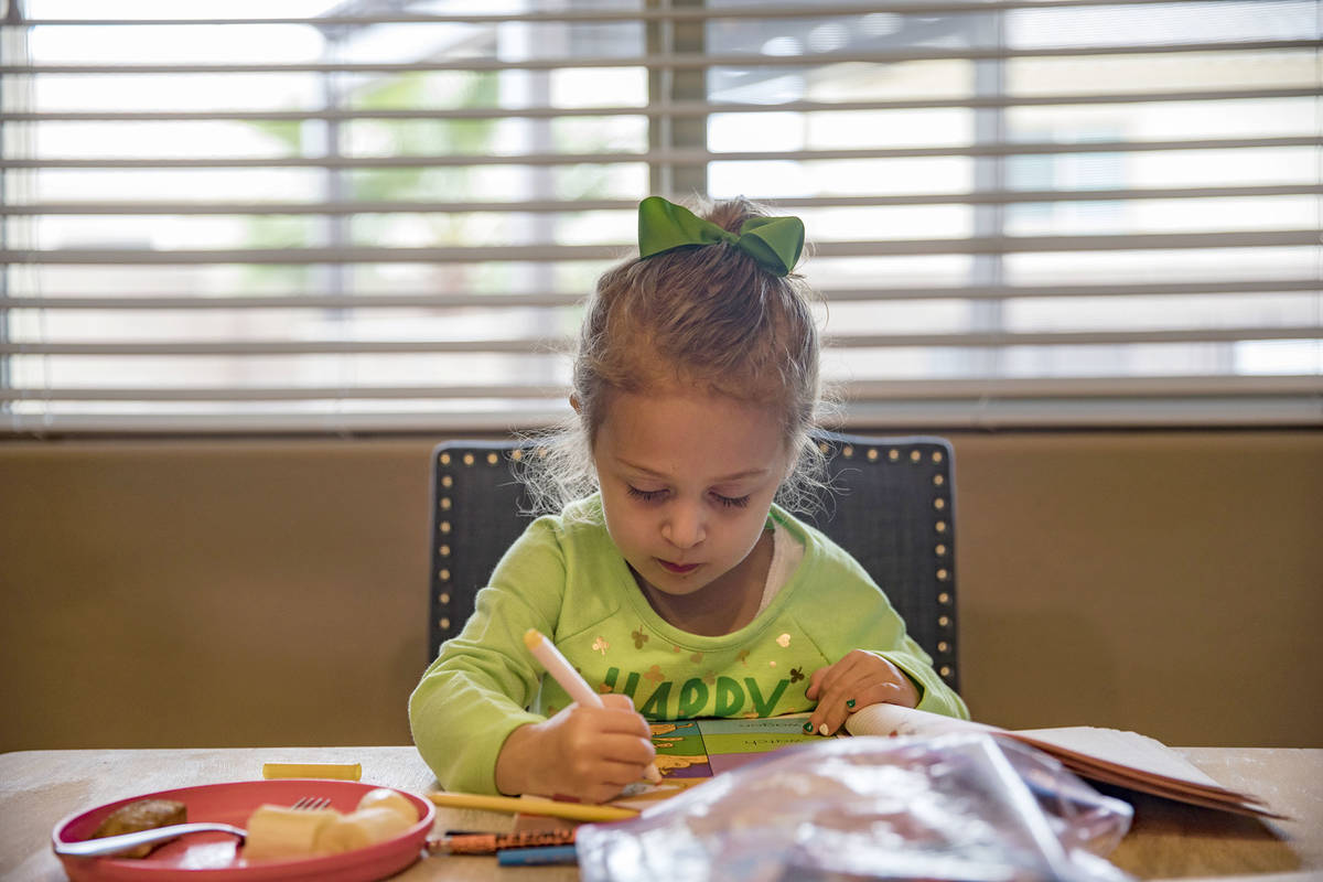 Angie Dolechal, 3, colors at her home in Henderson, Tuesday, March 17, 2020. Clark County Schoo ...
