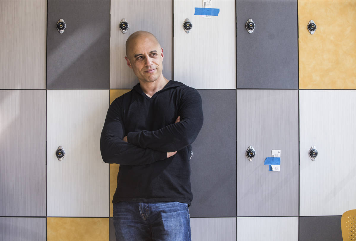 """Dr. Zubin Damania, AKA """"ZDoggMD,"""" listens to input from his crew during filming for a ..."""