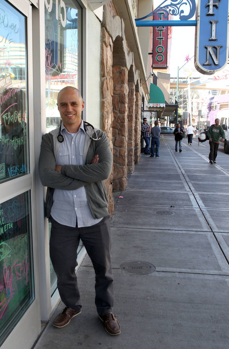 Zubin Damania, the Downtown Doc, poses for a photo on Fremont Street in downtown Las Vegas, Mon ...