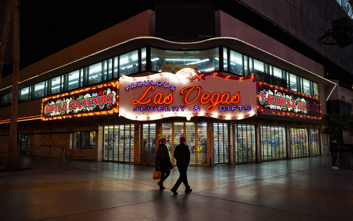 People walk past the closed Fabulous Las Vegas Jewelry & Gifts store at the Fremont Street ...
